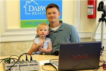 One year old Daniel Butler and Michael on remote broadcast for Tallassee Times TV at Dabwood Realty's Open House